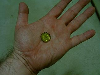 Logan's Run lifeclock crystal, yellow, on palm